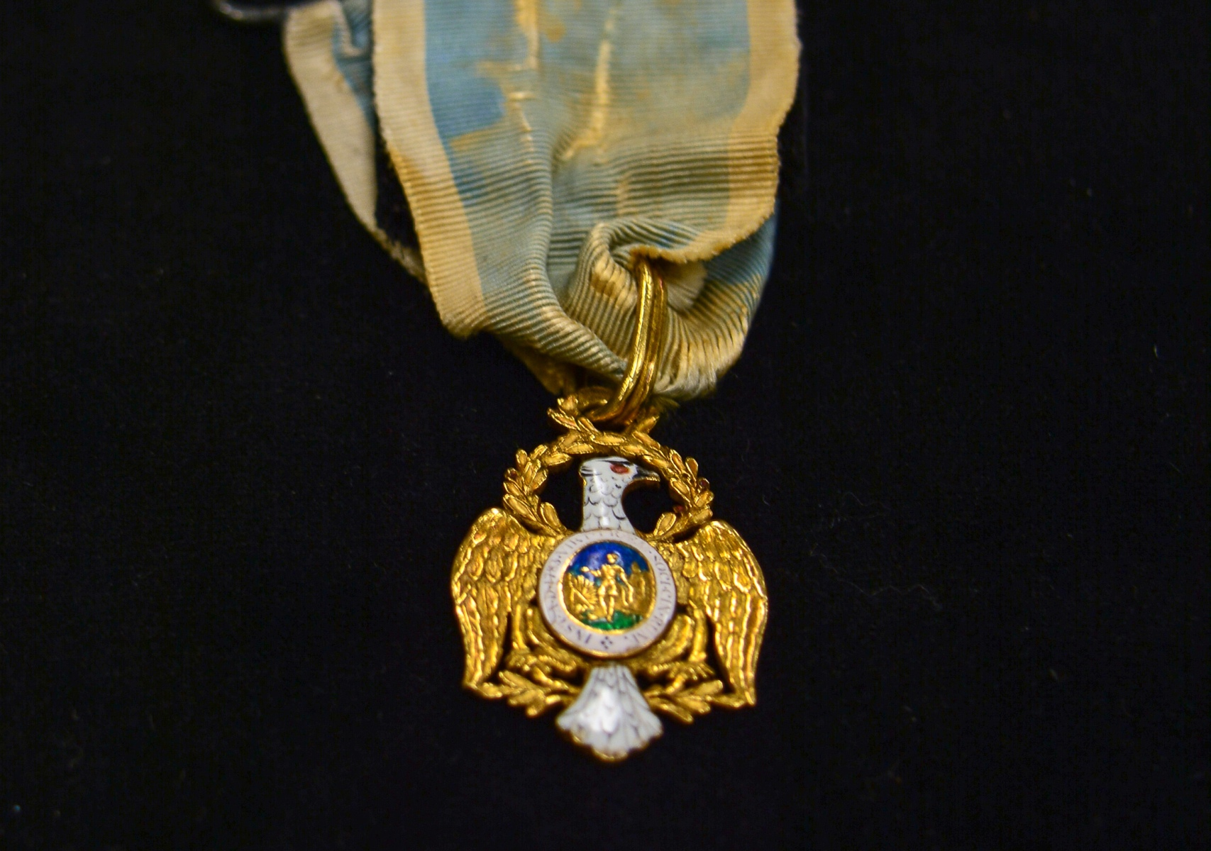 """A Society of the Cincinnati medal with eagle insignia. The Society of the Cincinnati was formed after the Revolutionary War. The medal is part of the """"Year of Hamilton"""" exhibit at the Museum of the American Revolution. Credit: MoAR"""