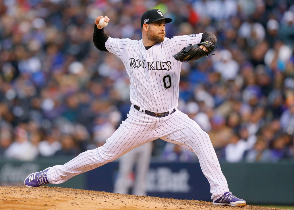 DENVER, CO - OCTOBER 07:  Adam Ottavino #0 of the Colorado Rockies pitches in the seventh inning of Game Three of the National League Division Series against the Milwaukee Brewers at Coors Field on October 7, 2018 in Denver, Colorado.  (Photo by Justin Edmonds/Getty Images)
