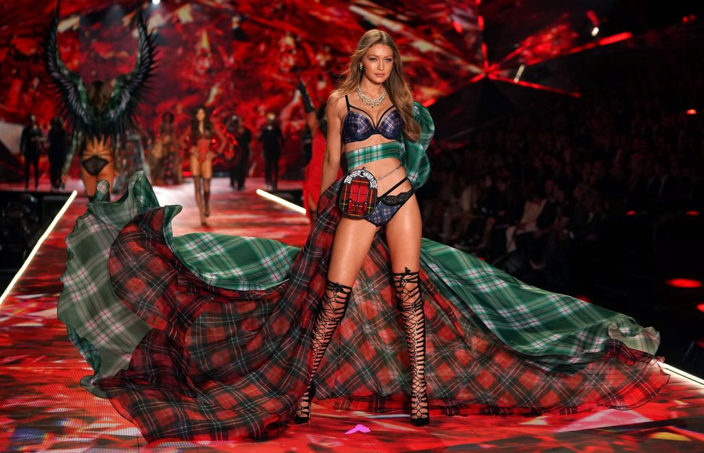 US model Gigi Hadid walks the runway at the 2018 Victoria's Secret Fashion Show on November 8, 2018 at Pier 94 in New York City. - Every year, the Victoria's Secret show brings its famous models together for what is consistently a glittery catwalk extravaganza. It's the most-watched fashion event of the year (800 million tune in annually) with around 12 million USD spent on putting the spectacle together according to Harper's Bazaar. (TIMOTHY A. CLARY/AFP/Getty Images)