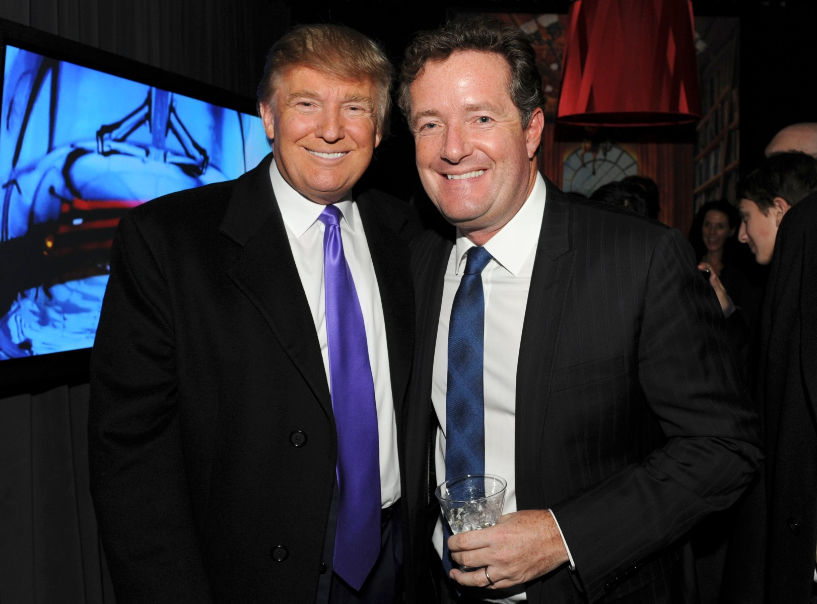 """Then-television personality Donald Trump and Piers Morgan attend the celebration of Perfumania and Kim Kardashians appearance on NBCs """"The Apprentice"""" at the Provocateur at The Hotel Gansevoort on November 10, 2010 in New York, New York.  (Photo by Mathew Imaging/WireImage)"""