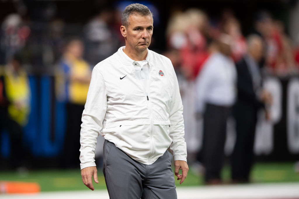 INDIANAPOLIS, IN - DECEMBER 01: Ohio State Buckeyes head coach Urban Meyer watches his team warm up before the Big 10 Championship game between the Northwestern Wildcats and Ohio State Buckeyes on December 1, 2018, at Lucas Oil Stadium in Indianapolis, IN. (Photo by Zach Bolinger/Icon Sportswire via Getty Images)