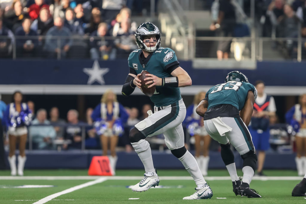 ARLINGTON, TX - DECEMBER 09: Philadelphia Eagles quarterback Carson Wentz (11) looks downfield for an open receiver during the game between the Dallas Cowboys and the Philadelphia Eagles on December 9, 2018 at AT&T Stadium in Arlington. Texas. (Photo by Matthew Pearce/Icon Sportswire via Getty Images)