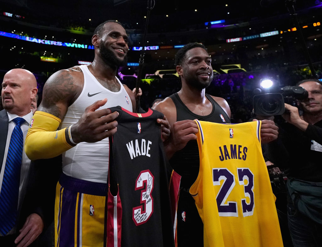 LOS ANGELES, CA - DECEMBER 10:  LeBron James #23 of the Los Angeles Lakers and Dwyane Wade #3 of the Miami Heat pose for a photo after exchanging jerseys, as Wade plans to retire at the end of the season, after a 108-105 Laker win at Staples Center on December 10, 2018 in Los Angeles, California. (Photo by Harry How/Getty Images)
