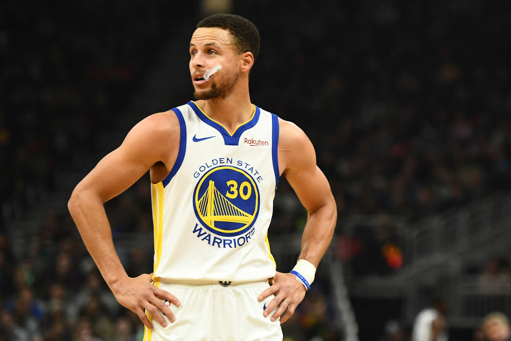 MILWAUKEE, WISCONSIN - DECEMBER 07: Stephen Curry #30 of the Golden State Warriors waits for a free throw during a game against the Milwaukee Buck at Fiserv Forum on December 07, 2018 in Milwaukee, Wisconsin. (Photo by Stacy Revere/Getty Images)