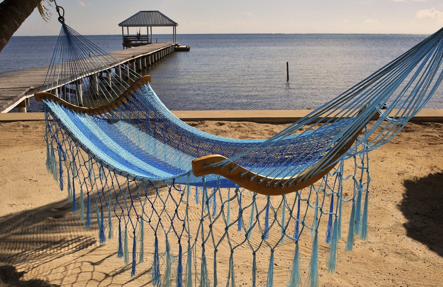 A view of a hammock on the beach on October 24, 2010 in the Island of Ambergris Caye, Belize, Central America.  hammock in carabbean islands, Ambergris Caye, Belize. (Photo by Philippe ROYER/Gamma-Rapho via Getty Images)