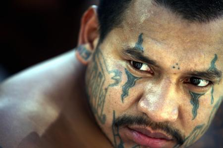 "A member of the ""Mara Salvatrucha"" gang is presented to the press in San Salvador on September 7th, 2006, after his arrest last night. (Yuri Cortez/AFP/Getty Images)"
