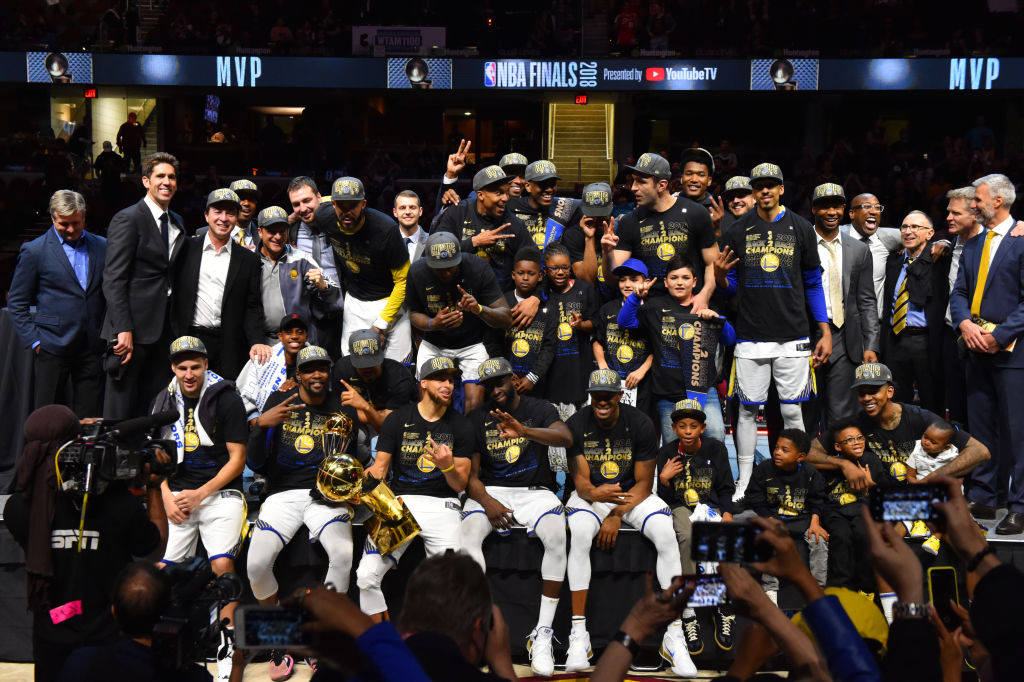 The Golden State Warriors team poses for a photo after defeating the Cleveland Cavaliers in Game Four of the 2018 NBA Finals to become the 2018 NBA Finals Champions on June 8, 2018 at Quicken Loans Arena in Cleveland, Ohio. (Photo by Jesse D. Garrabrant/NBAE via Getty Images)