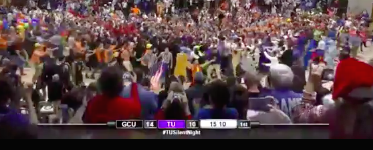 "Screenshot of Taylor University fans storming the court during the school's annual ""Silent Night"" game. (Photo: ESPN)"