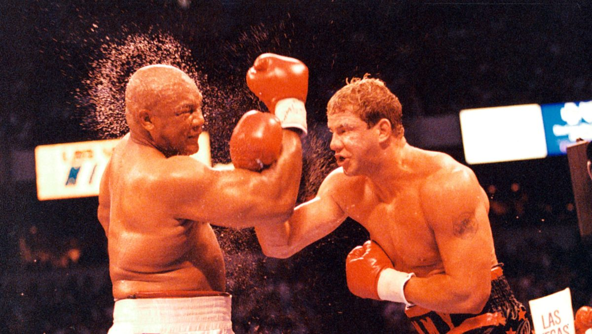 LAS VEGAS - JUNE 7, 1993: Tommy Morrison (R) connects with a right punch against George Foreman at the Thomas & Mack Center, on June 7,1993 in Las Vegas, Nevada. Tommy Morrison won by a UD 12 to claim a share of the heavyweight championship. (The Ring Magazine/Getty Images)