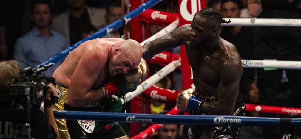 Reigning champion Deontay Wilder (right) lands a right hand against Tyson Fury during a WBC heavyweight title fight at the Staples Center in Los Angeles, California on December 01, 2018.  (Photo by Philip Pacheco/Anadolu Agency/Getty Images)