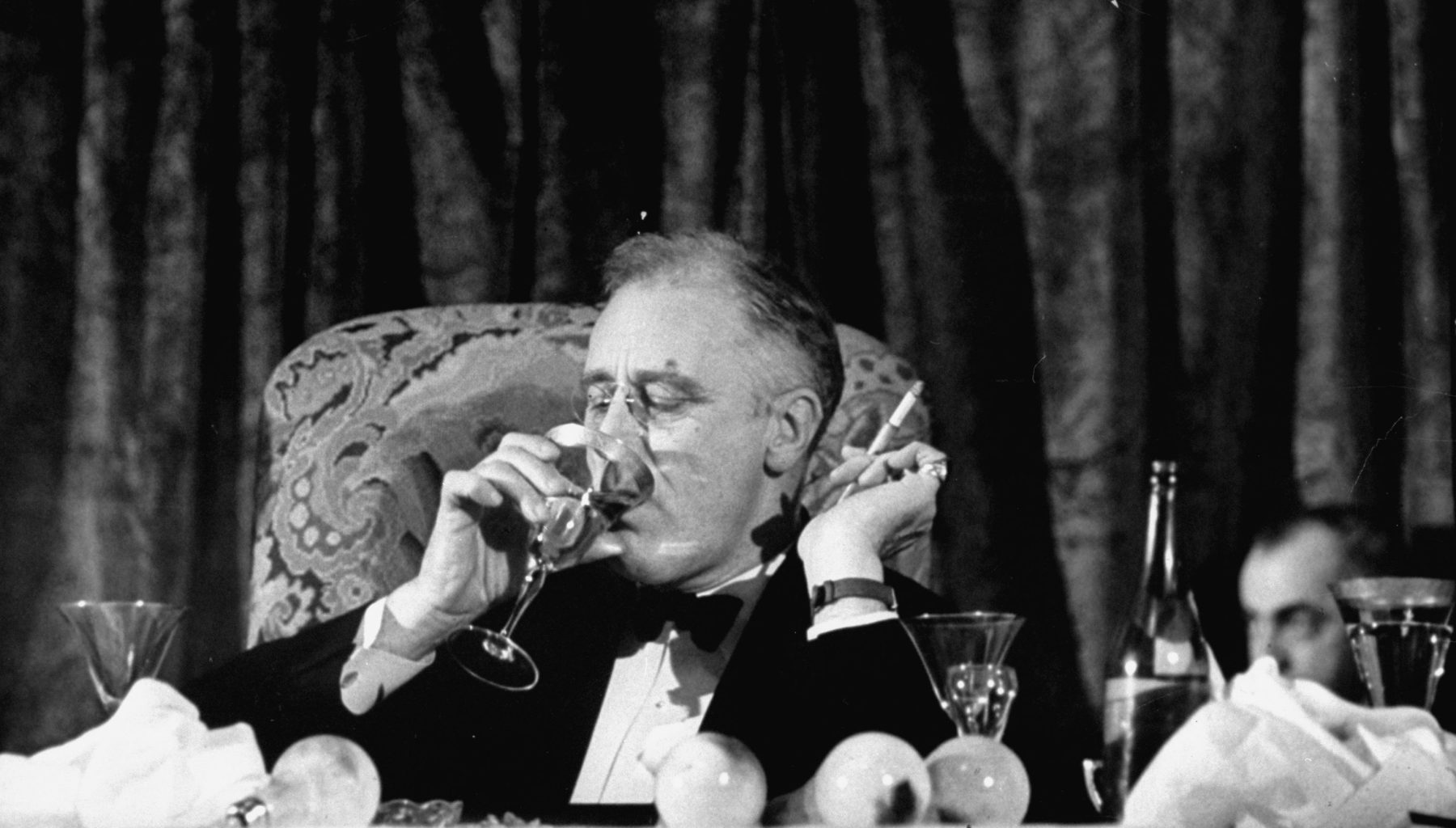 Pres. Franklin Roosevelt drinking white wine as he listens to Speaker Bankhead Jackson Day dinner speech during a Democratic fundraiser. FDR won four presidential elections. (Thomas D. Mcavoy/The LIFE Picture Collection/Getty Images)