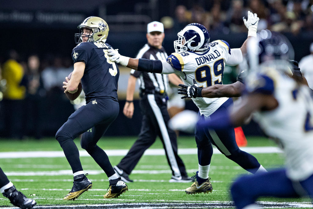 NEW ORLEANS, LA - NOVEMBER 4:  Aaron Donald #99 of the Los Angeles Rams gets a hand on Drew Brees #9 of the New Orleans Saints at Mercedes-Benz Superdome on November 4, 2018 in New Orleans, Louisiana.  The Saints defeated the Rams 45-35.  (Photo by Wesley Hitt/Getty Images)