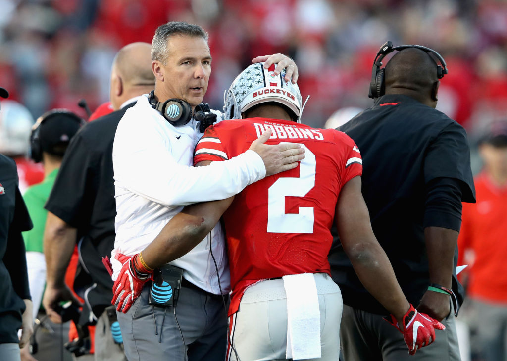PASADENA, CA - JANUARY 01:  Ohio State Buckeyes head coach Urban Meyer and J.K. Dobbins #2 of the Ohio State Buckeyes celebrate a touchdown during the second half in the Rose Bowl Game presented by Northwestern Mutual at the Rose Bowl on January 1, 2019 in Pasadena, California.  (Photo by Sean M. Haffey/Getty Images)