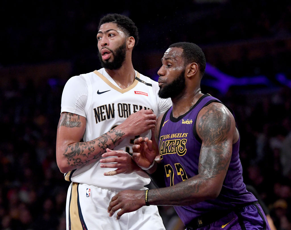 LOS ANGELES, CALIFORNIA - DECEMBER 21:  LeBron James #23 of the Los Angeles Lakers guards Anthony Davis #23 of the New Orleans Pelicans during a 112-104 Laker win at Staples Center on December 21, 2018 in Los Angeles, California. (Photo by Harry How/Getty Images)