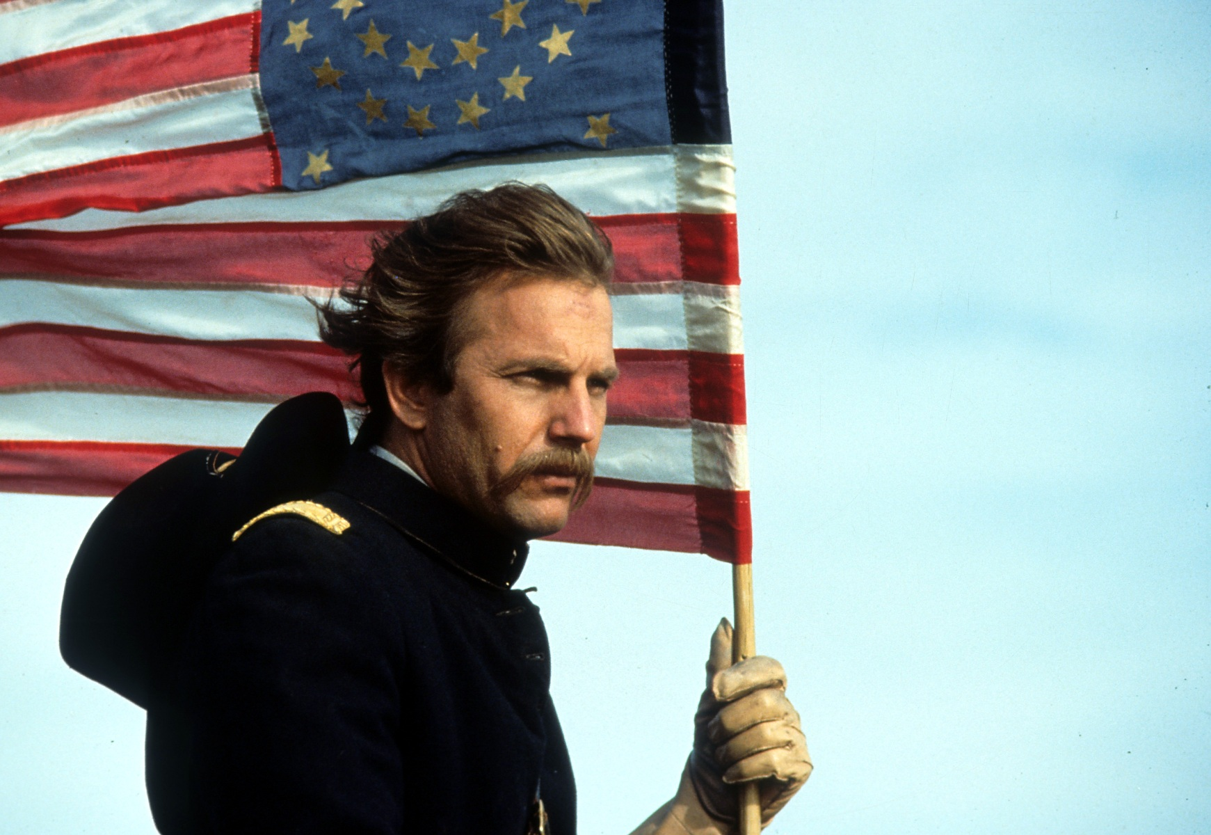 Kevin Costner holding an American flag in a scene from the film 'Dances With Wolves', 1990. (Getty Images)