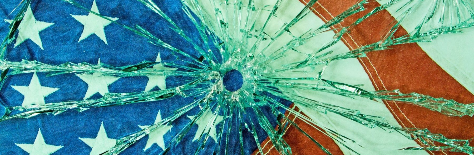 A safety glass with a bullet hole through the glass. (Getty Images)