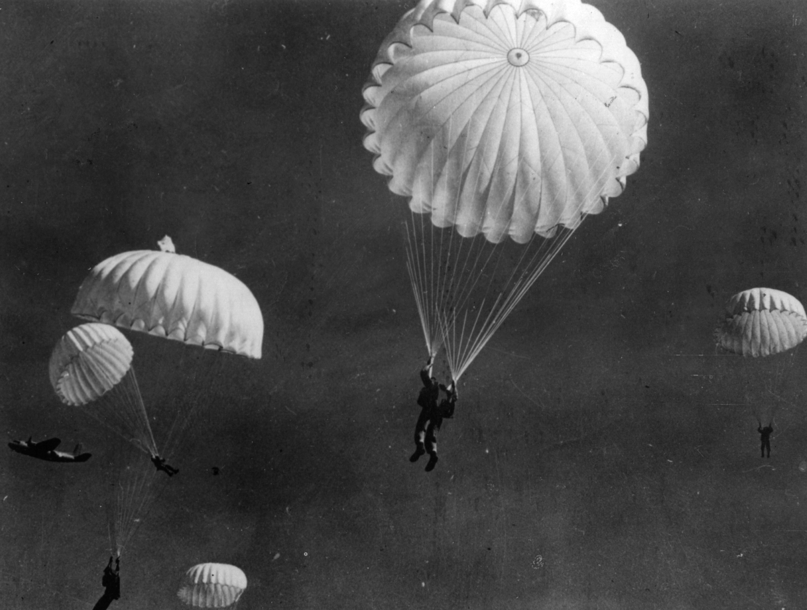These paratroopers, members of US Paramarine troops, take a practice jump -- similar to what carpetbaggers may have been required to do -- in 1943. (Getty Images)