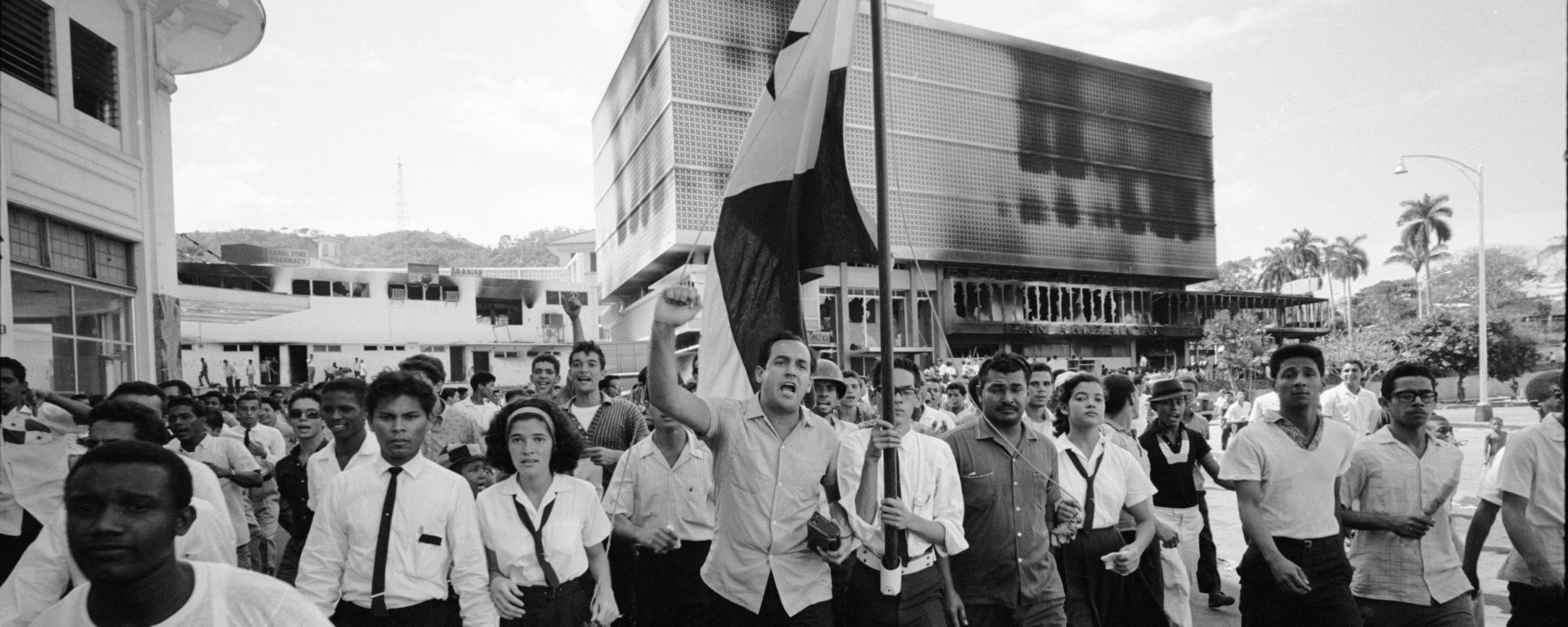 Panamanians march in protest near the Presidential Palace during riots over the sovereignity of Panama Canal Zone, Panama, 1964. (Photo by Michael Rougier/The LIFE Picture Collection/Getty Images)