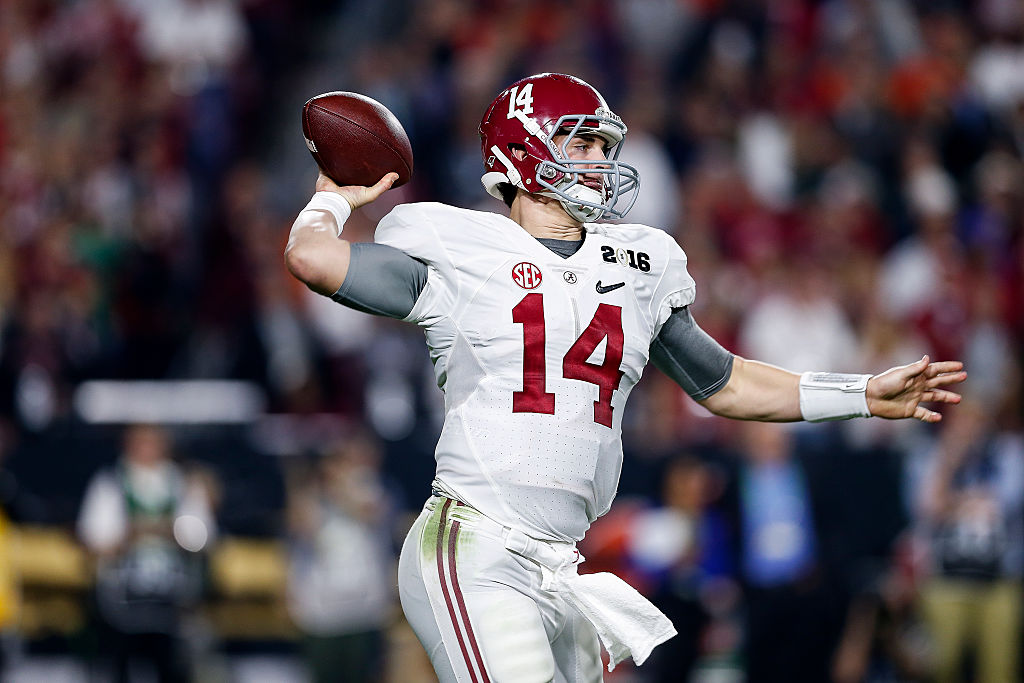 GLENDALE, AZ - JANUARY 11: Alabama Crimson Tide Quarterback Jake Coker #14 on a passing play during the College Football National Championship Game against the Clemson Tigers at University of Phoenix Stadium on January 11, 2016 in Glendale, Arizona. The Alabama Crimson Tide defeated the Clemson Tigers 45-41. (Photo by Don Juan Moore/Getty Images)