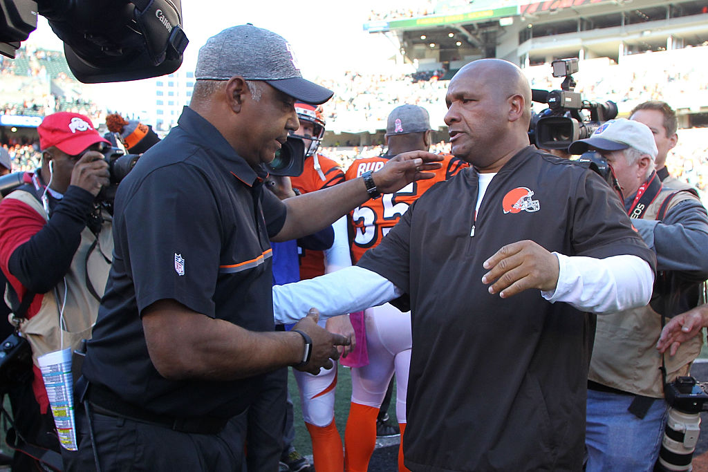 Head Coach Marvin Lewis of the Cincinnati Bengals and Head Coach Hue Jackson of the Cleveland Browns shake hands after the completion of the game at Paul Brown Stadium on October 23, 2016 in Cincinnati, Ohio. (Photo by John Grieshop/Getty Images)