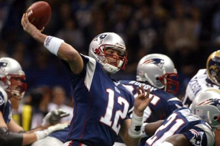 Patriots' Tom Brady throws a touchdown pass in the second quarter. New England Patriots face the St. Louis Rams in Super Bowl XXXVI at the Louisiana Superdome in New Orleans, LA on Feb. 3, 2002. (Photo by Bill Greene/The Boston Globe via Getty Images)