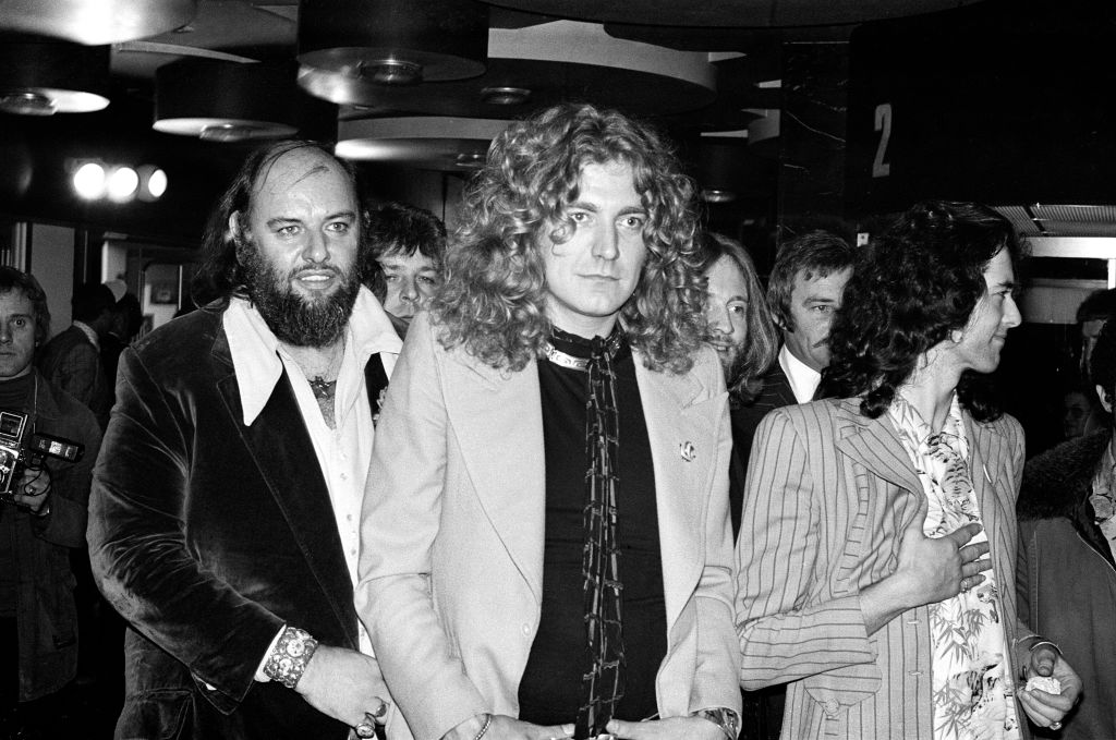 Rock band Led Zeppelin at the UK premier of the concert film 'The Song Remains The Same'. Pictured from left to right, manager Peter Grant, Robert Plant and Jimmy Page, 4th November 1976. (Photo by G Morris/Mirrorpix/Getty Images)