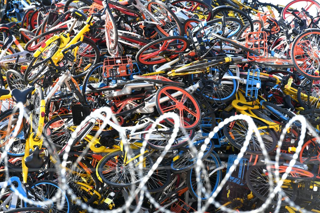 Over a hundred thousand shared bikes are piled up at an open area in Tong'an District on January 13, 2018 in Xiamen, Fujian Province of China. (Photo by Wang Dongming/China News Service/VCG via Getty Images)