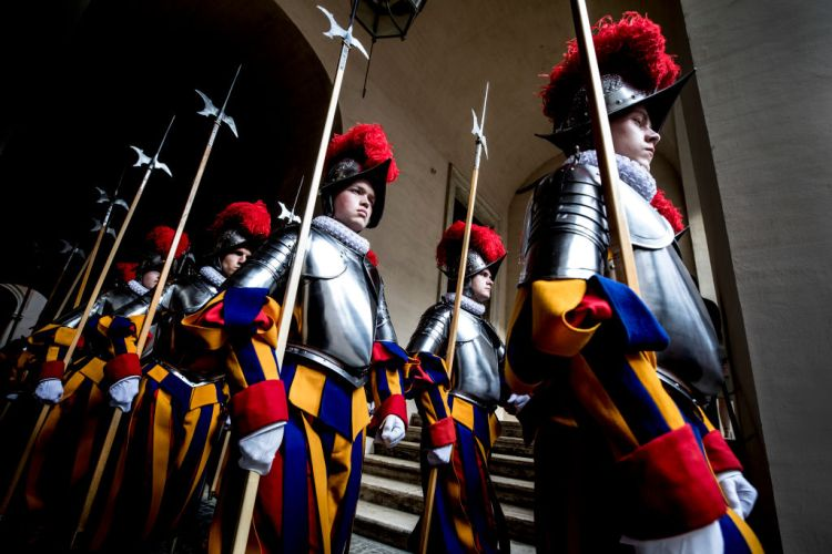 33 new Vatican Swiss Guards recruits prepare to be sworn in during a ceremony at St. Damaso courtyard on May 6, 2018 in Vatican City, Vatican. The annual swearing in ceremony for the New Papal Swiss Guards takes place every year on May 6, commemorating the 147 soldiers who died defending Pope Clement VII on the same day in 1527 during the sack of Rome. (Photo by Alessandra Benedetti - Corbis/Corbis via Getty Images)