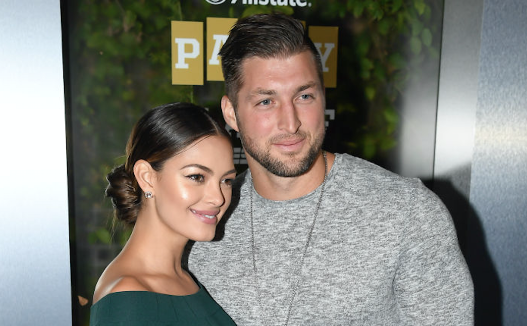 SAN JOSE, CA - JANUARY 05: (L-R) Miss Universe 2017 Demi-Leigh Nel-Peters and Tim Tebow of ESPN attend the Party At The Playoff at The GlassHouse on January 5, 2019 in San Jose, California. (Photo by Steve Jennings/Getty Images for ESPN)