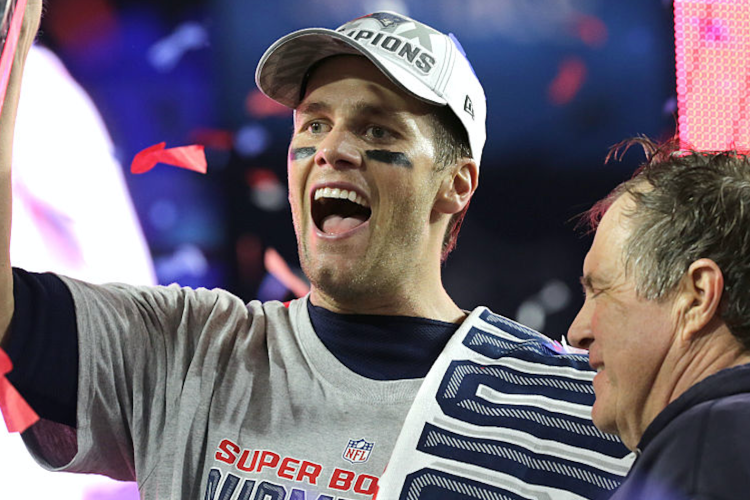 Patriots quarterback Tom Brady and coach Bill Belichick pose with the trophy at the post-game ceremony and celebration after the Patriots won Super Bowl XLIX. (Photo by Barry Chin/The Boston Globe via Getty Images)
