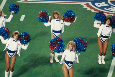 MINNEAPOLIS, MN - JANUARY 26: The Buffalo Bills cheerleaders, the 'Jills' cheer before their team took on the Washington Redskins in Super Bowl XXVI at the Metrodome on January 26, 1992 in Minneapolis, Minnesota. The Redskins defeated the Bills 37-24. (Photo by Gin Ellis/Getty Images)