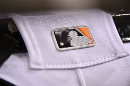 MIAMI, FL - SEPTEMBER 18: A detail view of the MLB logo on the baseball pants of Starlin Castro of the Miami Marlins during the game against the Washington Nationals at Marlins Park on September 18, 2018 in Miami, Florida. (Photo by Mark Brown/Getty Images)