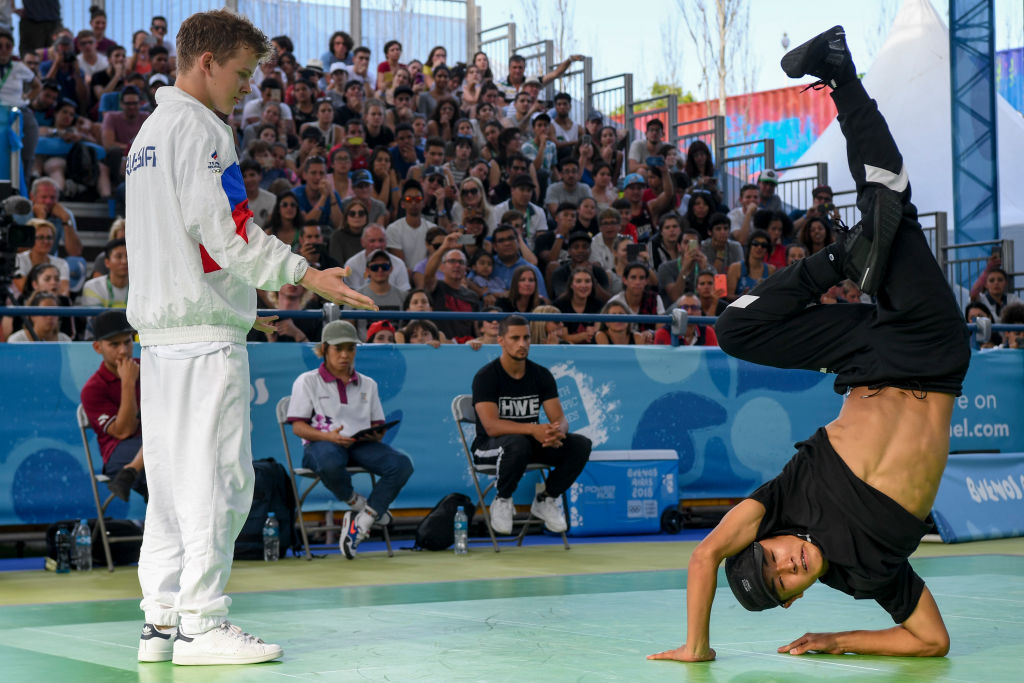 Japan's b-boy Shigelix (R) competes against Russia's b-boy Bumblebee during a battle at the Youth Olympic Games in Buenos Aires, Argentina on October 08, 2018. - The Youth Olympic Games in Buenos Aires hosted the world's best youth break dancers to compete for the first ever Olympic medal in the athletic art. (Photo by EITAN ABRAMOVICH / AFP/Getty Images)