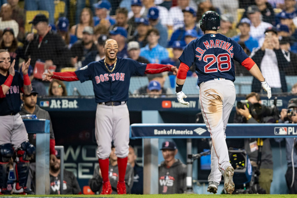 LOS ANGELES, CA - OCTOBER 28: J.D. Martinez #28 of the Boston Red Sox reacts with Mookie Betts #50 after hitting a solo home run during the seventh inning of game five of the 2018 World Series against the Los Angeles Dodgers on October 28, 2018 at Dodger Stadium in Los Angeles, California. (Photo by Billie Weiss/Boston Red Sox/Getty Images)