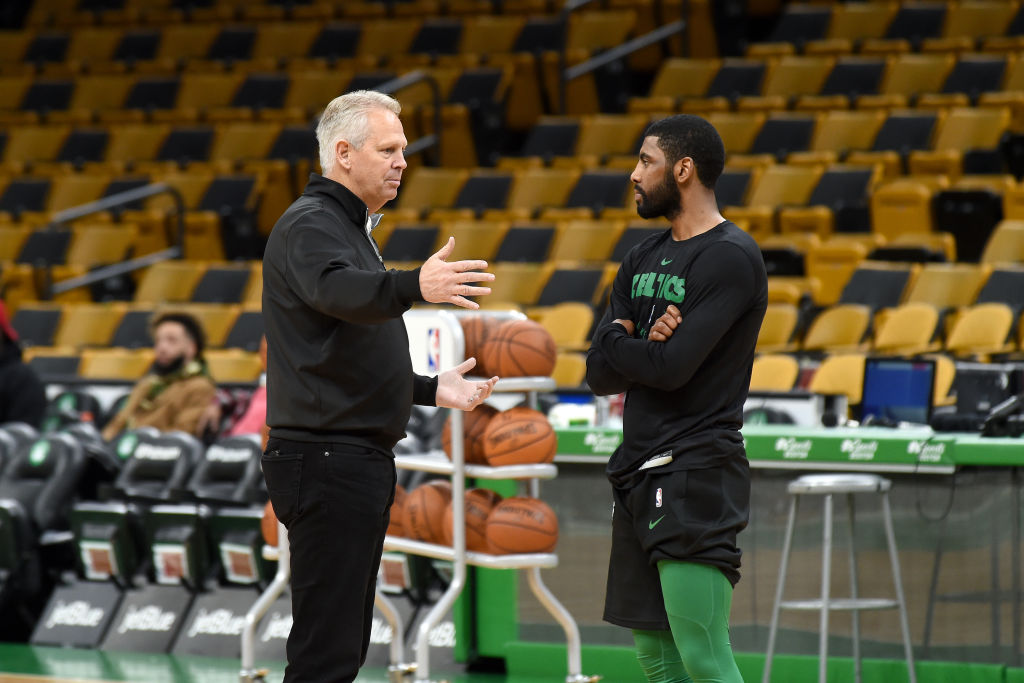 BOSTON, MA - NOVEMBER 17: General Manager Danny Ainge and Kyrie Irving #11 of the Boston Celtics talk before the game against the Utah Jazz on November 17, 2018 at the TD Garden in Boston, Massachusetts.(Photo by Steve Babineau/NBAE via Getty Images)