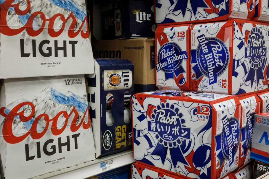 Packs of beer sit for sale at a convenience store. (Drew Angerer/Getty Images)