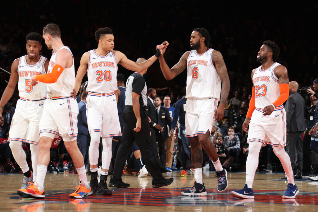 NEW YORK, NY - FEBRUARY 3: Kevin Knox #20 of the New York Knicks high-fives DeAndre Jordan #6 of the New York Knicks against the Memphis Grizzlies on February 3, 2019 at Madison Square Garden in New York City, New York. (Photo by Nathaniel S. Butler/NBAE via Getty Images)