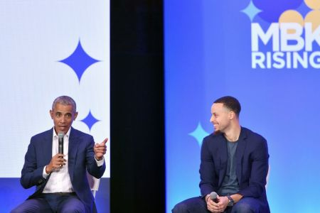 Former President Barack Obama (L) speaks alongside Golden State Warriors basketball player Stephen Curry (R) during the MBK Rising! My Brother's Keeper Alliance Summit in Oakland, California on February 19, 2019. (Photo by Josh Edelson / AFP)        (Photo credit should read JOSH EDELSON/AFP/Getty Images)