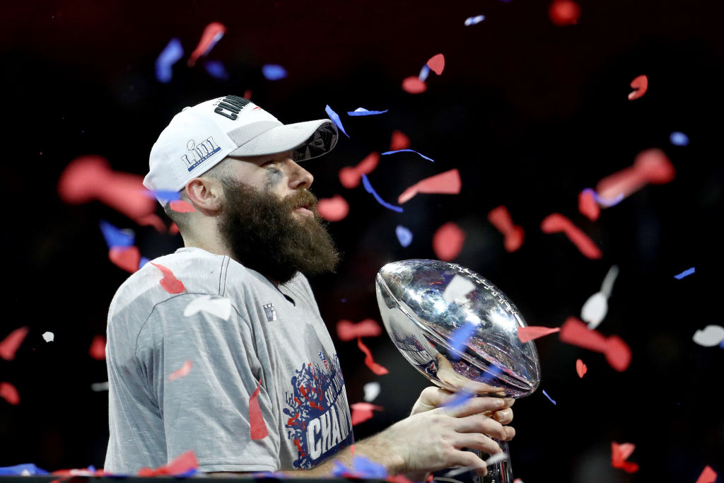 Julian Edelman #11 of the New England Patriots celebrates with the Vince Lombardi Trophy after his teams 13-3 win over the Los Angeles Rams during Super Bowl LIII at Mercedes-Benz Stadium on February 03, 2019 in Atlanta, Georgia. (Photo by Al Bello/Getty Images)