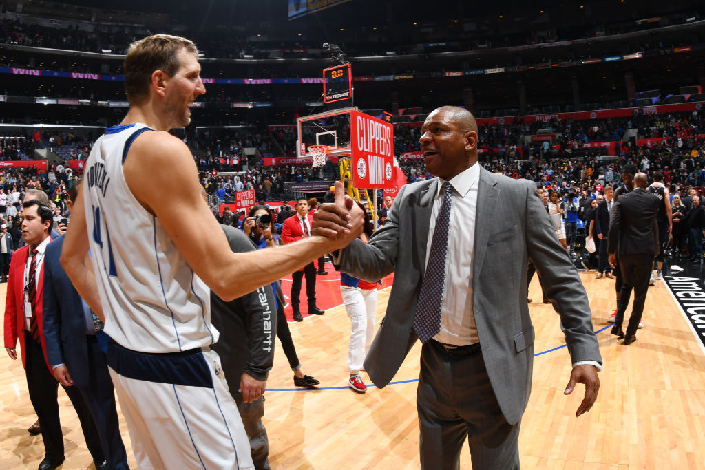 LOS ANGELES, CA - FEBRUARY 25: Dirk Nowitzki #41 of the Dallas Mavericks and Head Coach Doc Rivers of the LA Clippers shake hands after a game on February 25, 2019 at STAPLES Center in Los Angeles, California. (Photo by Adam Pantozzi/NBAE via Getty Images)