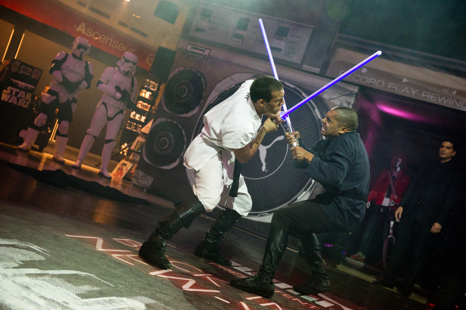 PARIS, FRANCE - SEPTEMBER 13: Cascade Demo Team members perform a Lightsaber fight at the Star Wars Saga release party at Virgin Megastore Champs-Elysees on September 13, 2011 in Paris, France. (Photo by Samuel Dietz/WireImage)