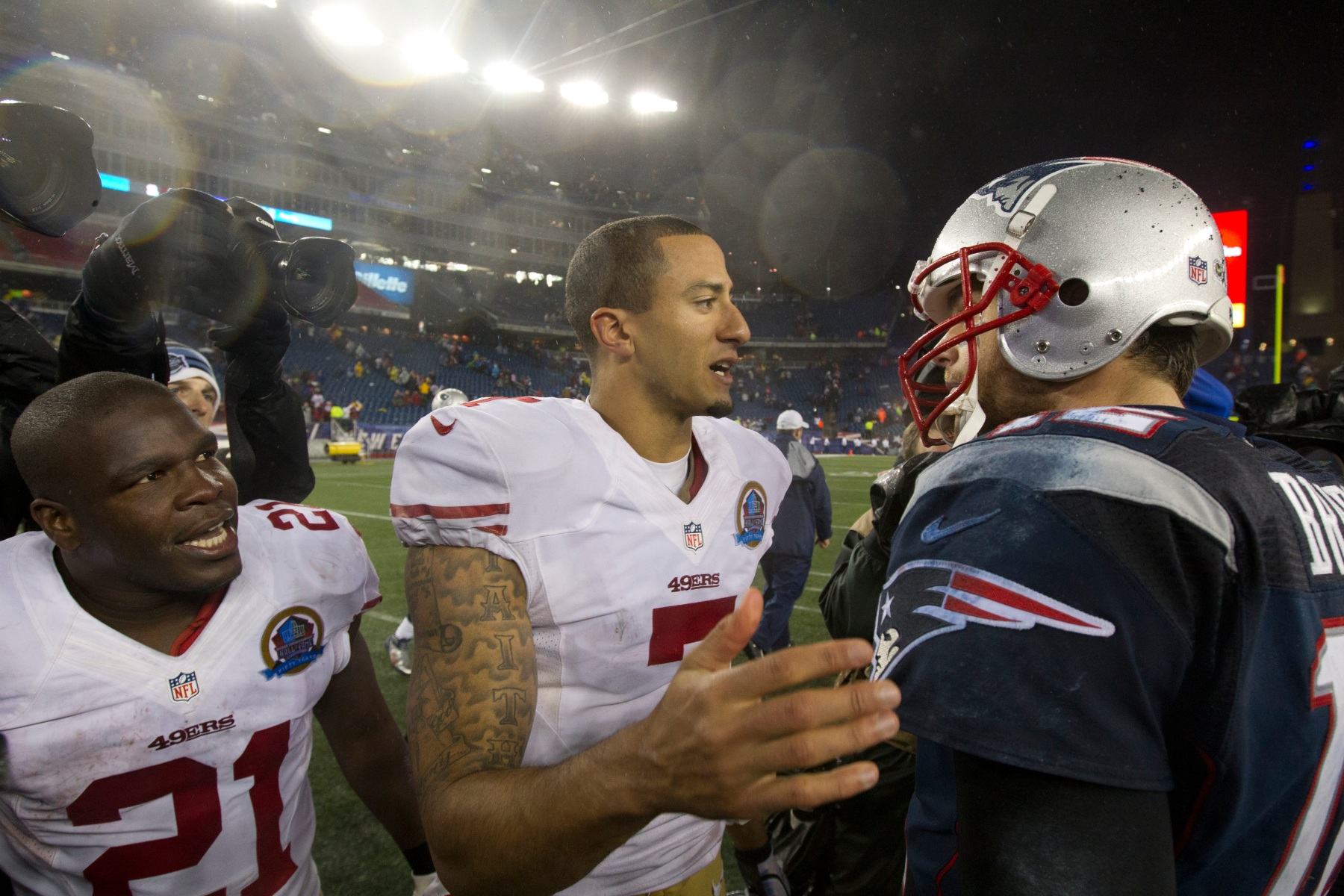 FOXBOROUGH, MA - DECEMBER 16: New England Patriots quarterback Tom Brady shakes hands with San Francisco 49ers Colin Kaepernikck and Frank Gore (#21) after the 49ers defeated the Patriots 41-34 at Gillette Stadium on Sunday, Dec. 16, 2012. (Photo by Matthew J. Lee/The Boston Globe via Getty Images)