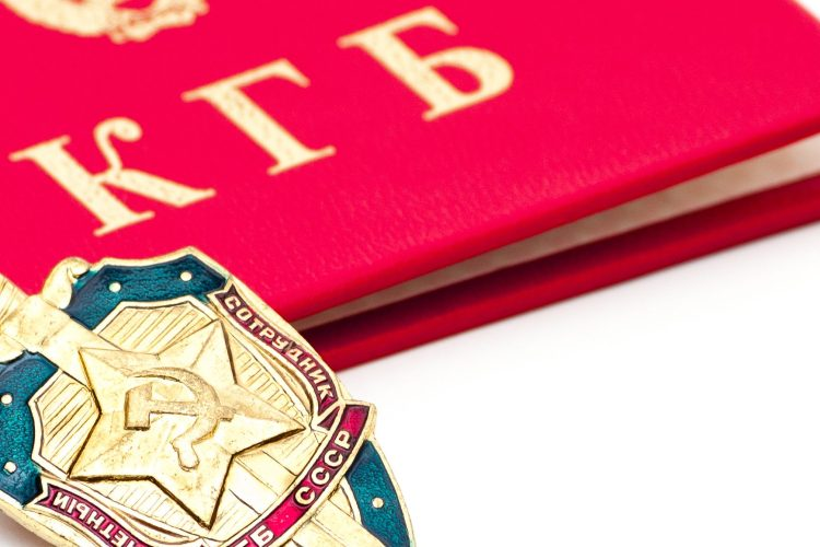 A KGB badge lays on a closed KGB identity book.   (Getty Images)