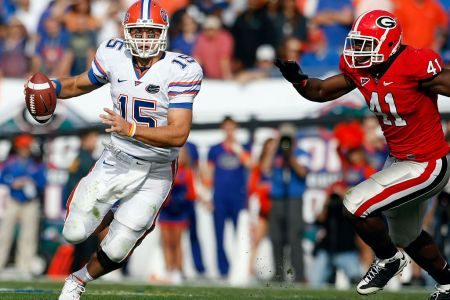 Florida quarterback Tim Tebow (15) scrambles as he is flushed from the pocket by Georgia defensive end Roderick Battle (41) in the Florida Gators 49-10 victory over the Georgia Bulldogs at Jacksonville Municipal Stadium in Jacksonville, FL. (Photo by Todd Kirkland /Icon SMI/Icon Sport Media via Getty Images)