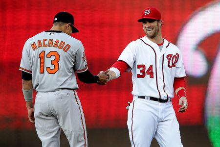 Washington Nationals left fielder Bryce Harper (34) greets Baltimore Orioles third base Manny Machado (13) before a MLB game at Nationals Park, in Washington D.C. (Photo by Tony Quinn/Icon SMI/Corbis via Getty Images)