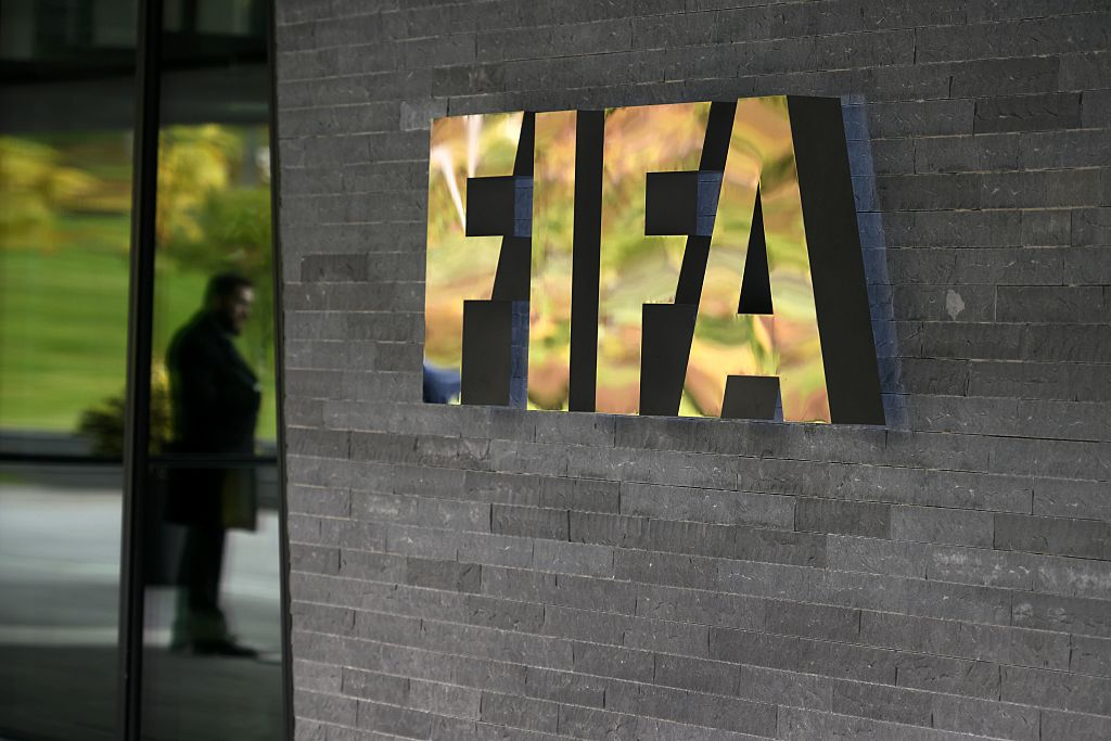 A sign of the FIFA is seen at the entrance of the world football's governing body headquarters on October 13, 2016 in Zurich. / AFP / FABRICE COFFRINI        (Photo credit should read FABRICE COFFRINI/AFP/Getty Images)