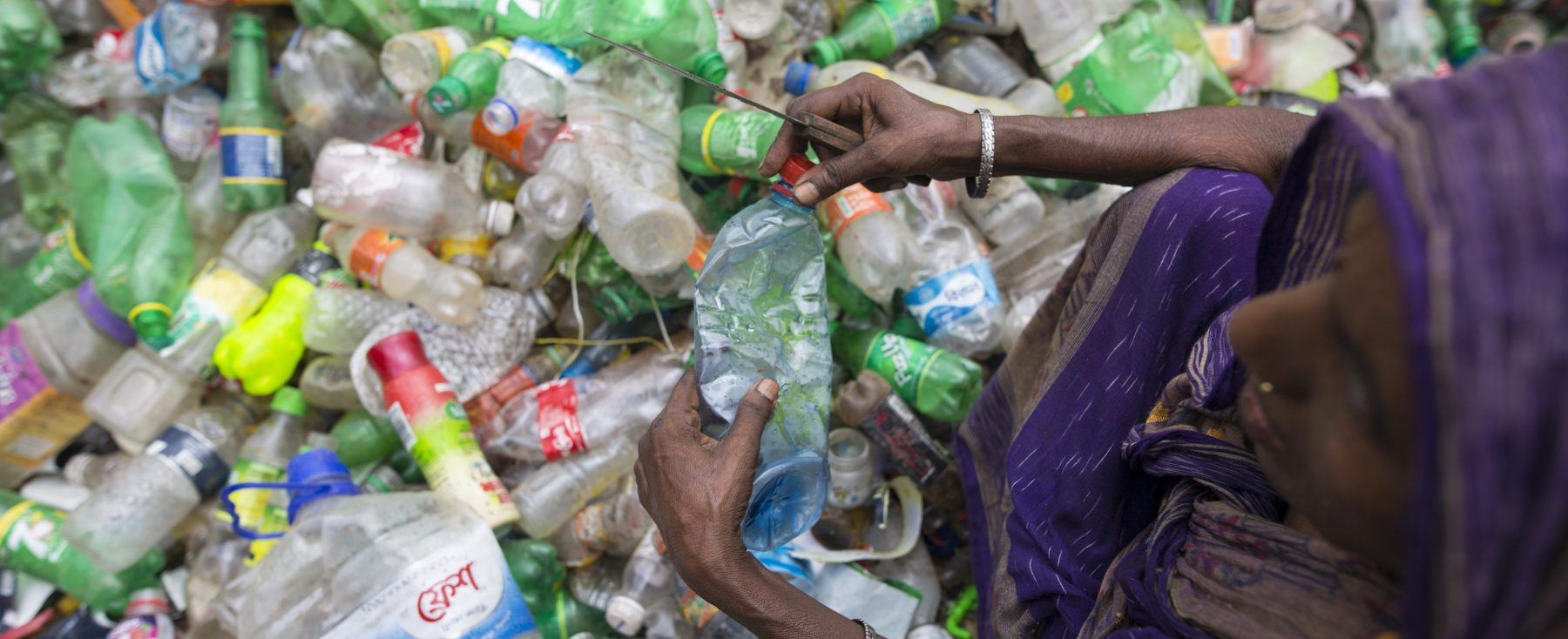 Female laborers sort through polyethylene terephthalate (PET) bottles in a recycling factory on July 06, 2017 in Dhaka, Bangladesh. (Zakir Chowdhury/Barcroft Images / Barcroft Media via Getty Images)