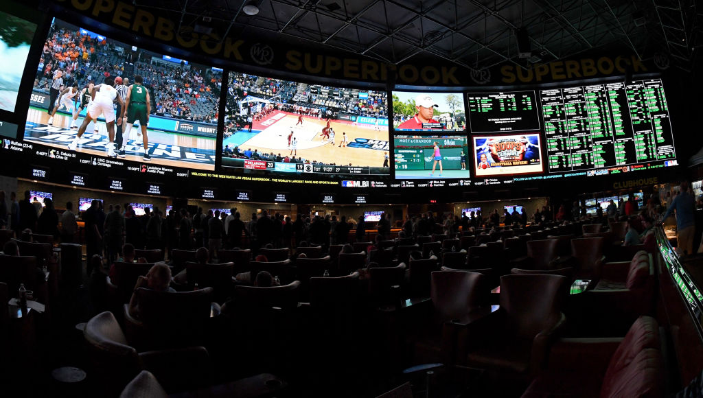 Guests attend a viewing party for the NCAA Men's College Basketball Tournament inside the 25,000-square-foot Race & Sports SuperBook at the Westgate Las Vegas Resort & Casino which features 4,488-square-feet of HD video screens on March 15, 2018 in Las Vegas, Nevada.  (Photo by Ethan Miller/Getty Images)