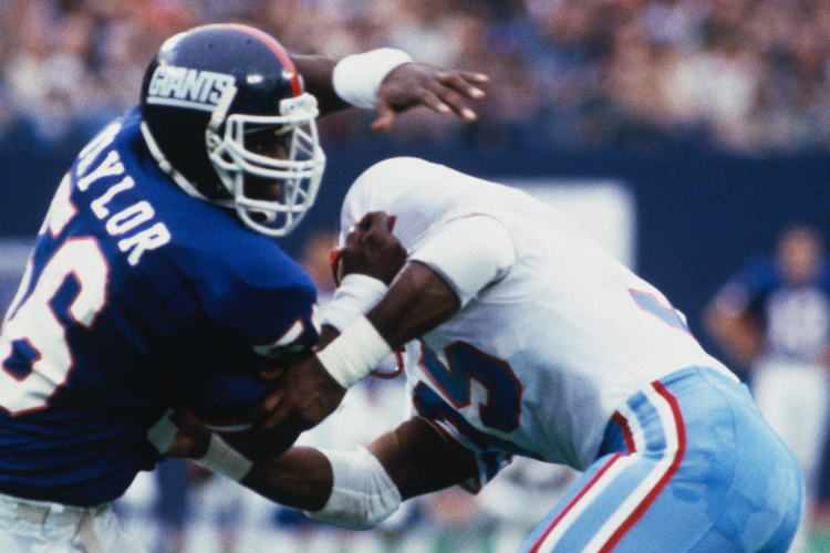 EAST RUTHERFORD, NJ: Lawrence Taylor #56 of the New York Giants pass rushes against the Houston Oilers during a circa 1980s game at Giants Stadium in East Rutherford, New Jersey. Taylor played for the Giants from 1981-93. (Photo by Focus Sport/Getty Images)