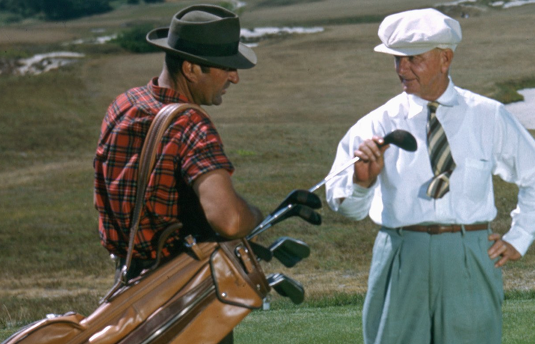 SOUTHAMPTON NY - 1950: A golfer and his caddy prepare to tee off at the National Golf Links of America Southampton New York in 1950. This photo was shot for the story 'America's Snootiest Golf Course' published in the April 22 1950 issue of the Saturday Evening Post. (Ivan Dmitri/Photo by Michael Ochs Archive/Getty Images)